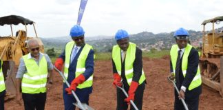 Right-left: NSSF Board Chairman, Patrick Kaberenge, Hon. Matia Kasaija, and NSSF Managing Director Richard Byarugaba breaking the ground for the construction of Lubowa Housing Project as one of the contractors looks on.