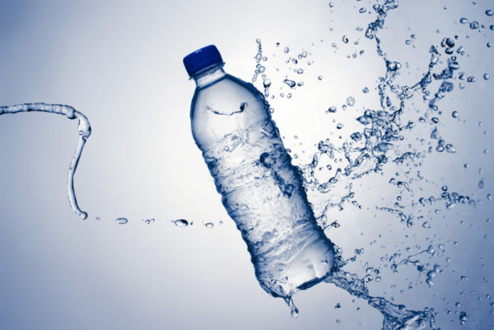 Bottled water comes under sharp scrutiny over microplastics